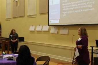 This is a picture of Virginia Ramseyer Winter and Michaella Ward presenting at a conference in St. Louis.