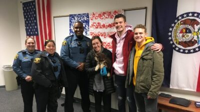 This is a picture of Sergeant Jennifer Perry, Officer Susan Huang, Officer John Hayes and MU students Katherine Matteson (holding Mia), Trevor Koelling and Riley Girardier.
