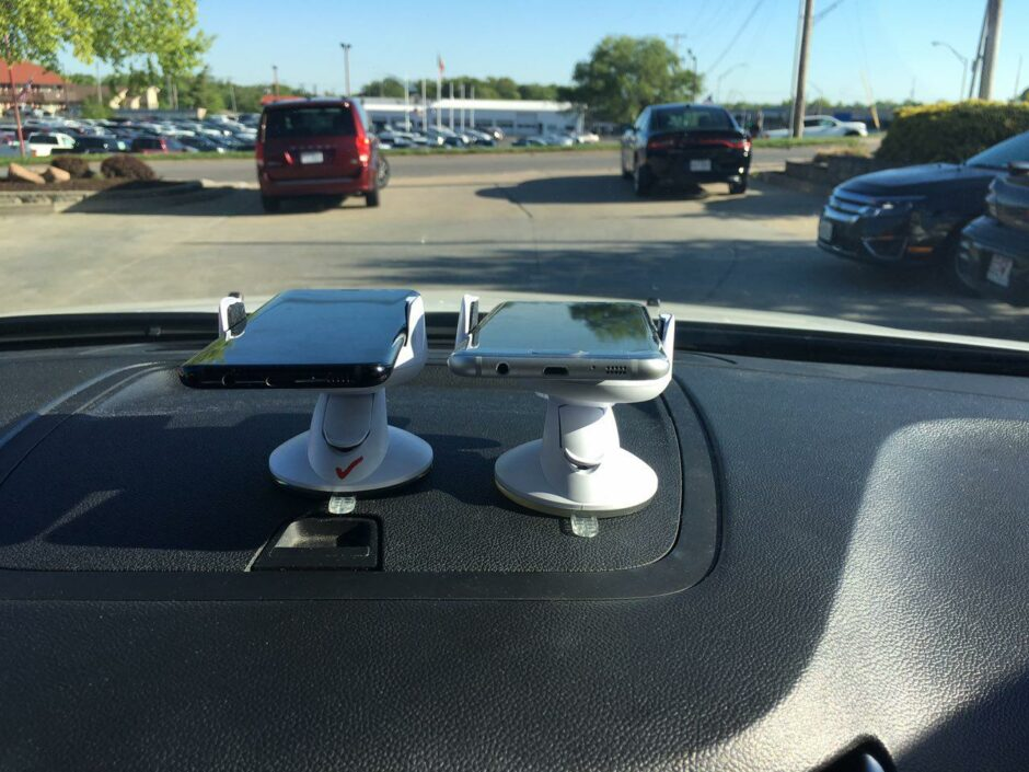 This is a picture of smartphones on a dashboard