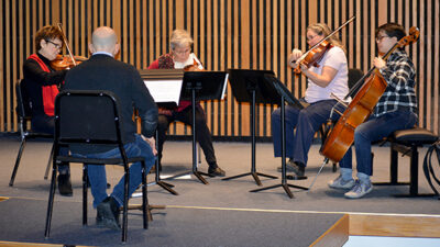 The Esterhazy Quartet rehearses a new composition by Andrew List which will premiere at the quartet's 50th anniversary concert in Whitmore Recital Hall March 4.