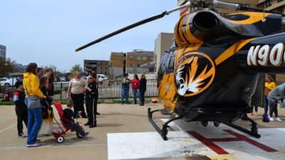 Families at Show Me Mizzou Day touring the helicopter