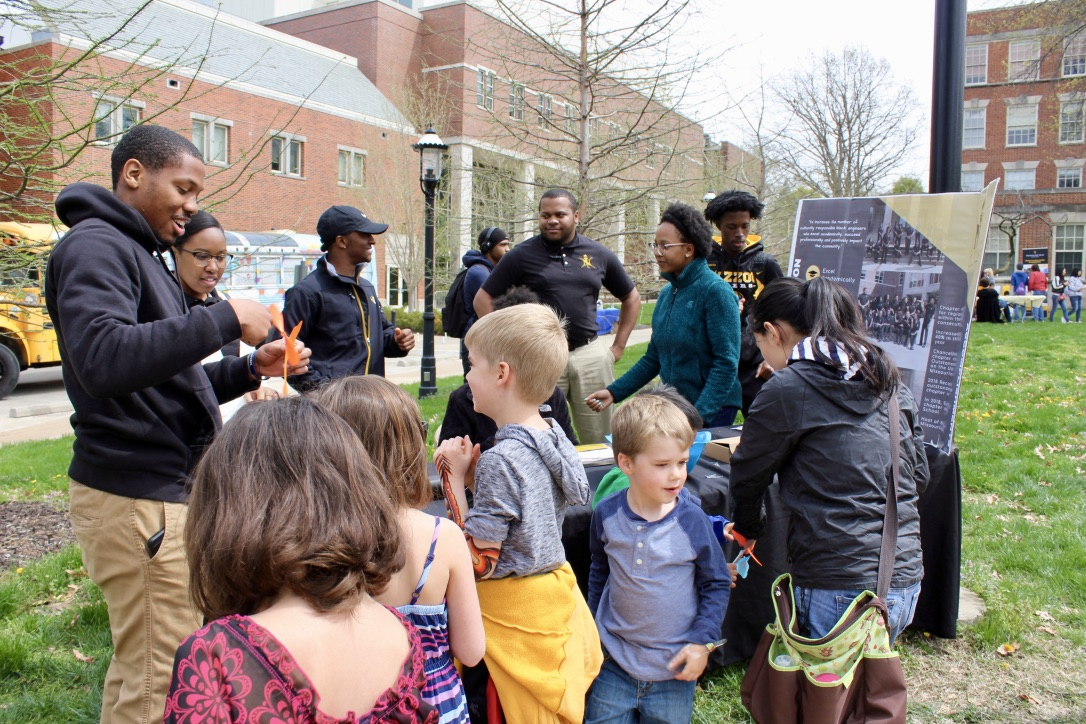 Members of the National Society of Black Engineers showed students how to build paper helicopters as part of the College's STEM Cubs Festival on Show Me Mizzou Day.