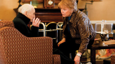 Marilyn Rantz speaks with an elderly man at a nursing home in Missouri.