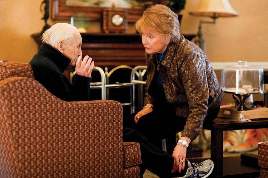 Marilyn Rantz speaks with an elderly man at a nursing home in Missouri.