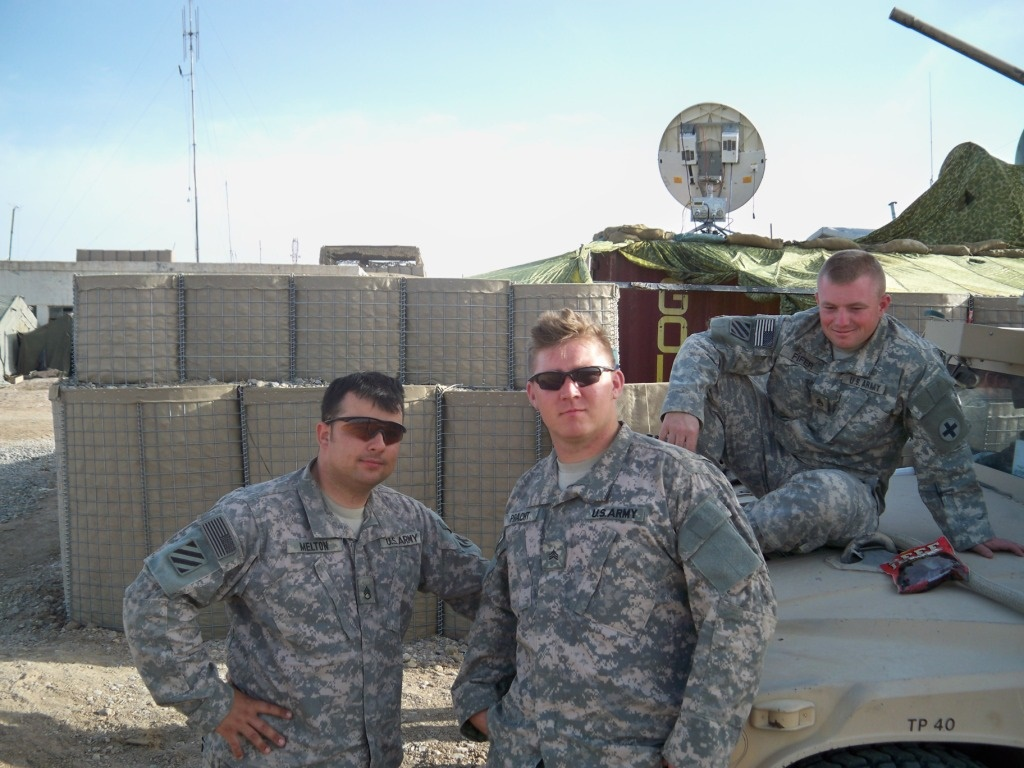Alex Pracht poses with fellow soldiers.