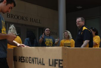 Chancellor Alexander N. Cartwright volunteers to assist freshmen as they move into Brooks Hall at Mizzou.