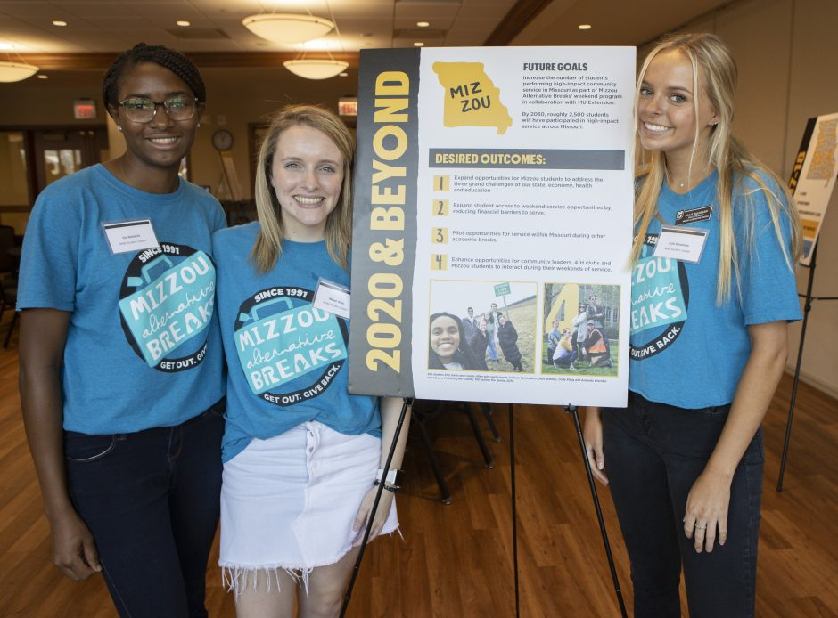 Mizzou Alternative Breaks student leaders Ola Babalola, Megan Allen and Lillie Bradshaw, recently celebrated the student led organization's partnership with MU Extension to serve all 114 counties in Missouri.
