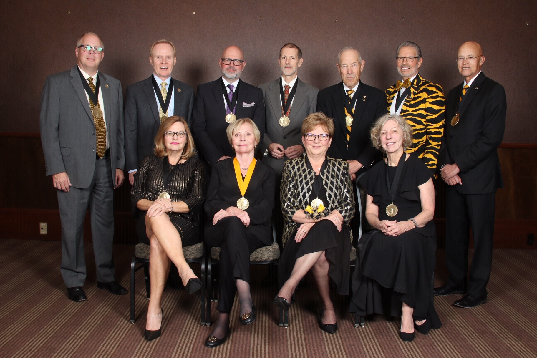 The Mizzou Alumni Association honored 12 distinguished faculty and alumni on Nov. 15. Honorees include (top row from left to right) J.D. Bowers, William Corrigan Jr., Scott Woelfel, Peter Vallentyne, Robert Banning, John Qualy and Michael Middleton. (front row left to right) Angela Drake, Margaret Duffy, Susan Donnell Scott and Jeanne Abbott. Thomas Lafferre not pictured.