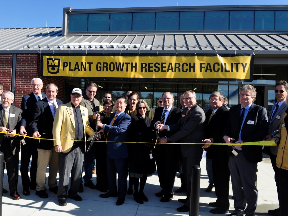 This is a picture of the ribbon-cutting at the East Campus Plant Growth Facility
