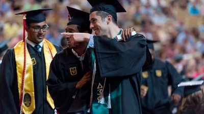 Mizzou students celebrating during a commencement ceremony.