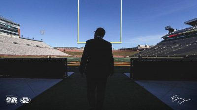 This is a picture of Eli Drinkwitz stepping onto Faurot Field