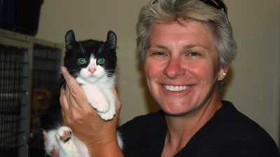 This is a photo of Leslie Lyons and a cat