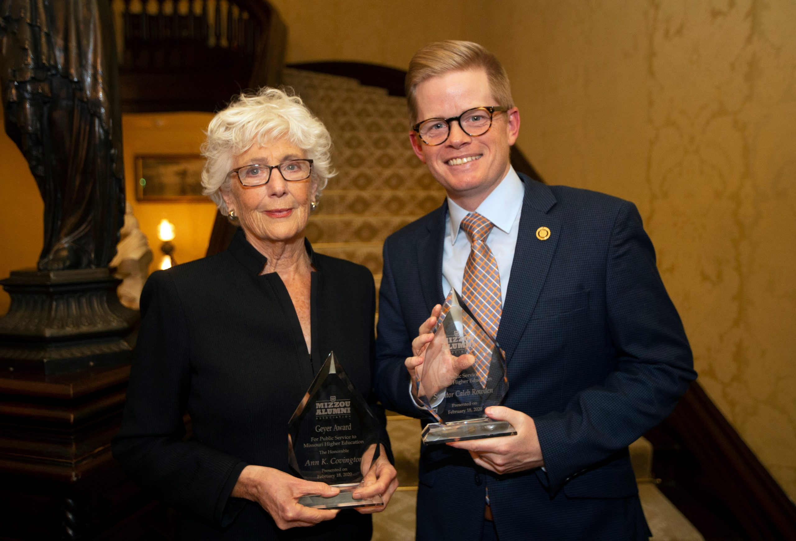 This is a picture of Ann Covington and Caleb Rowden posing wit their Geyer Awards at the Governor's Mansion.