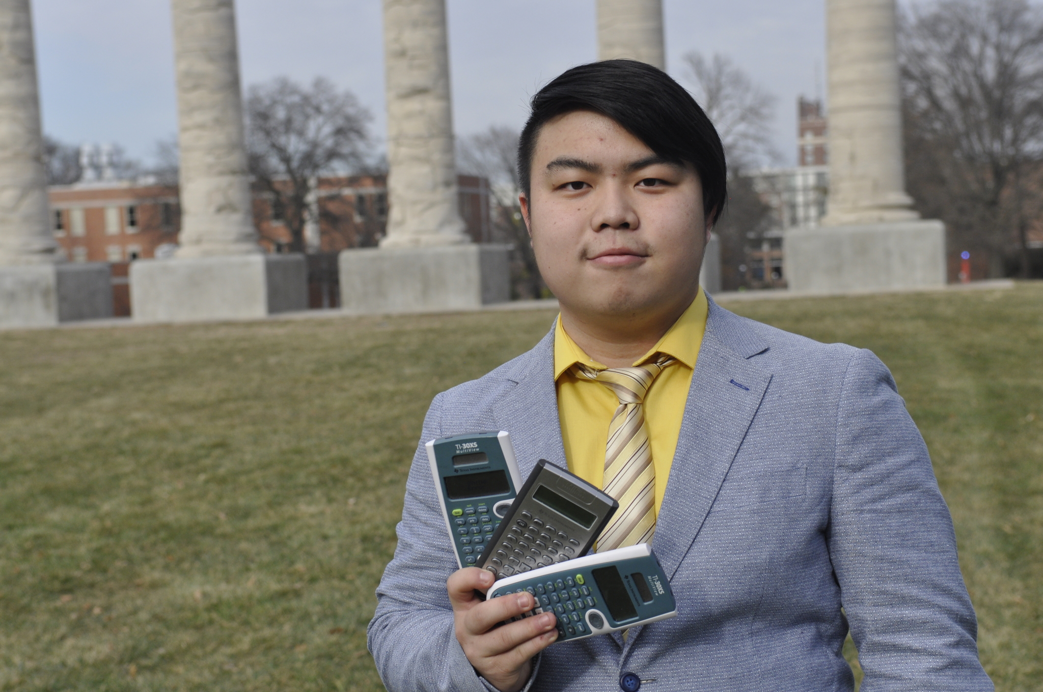 Xu shows off his calculator collection in front of the Columns