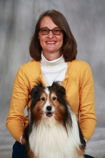 This is a photo of Dr. Carlisle and Mira the dog.