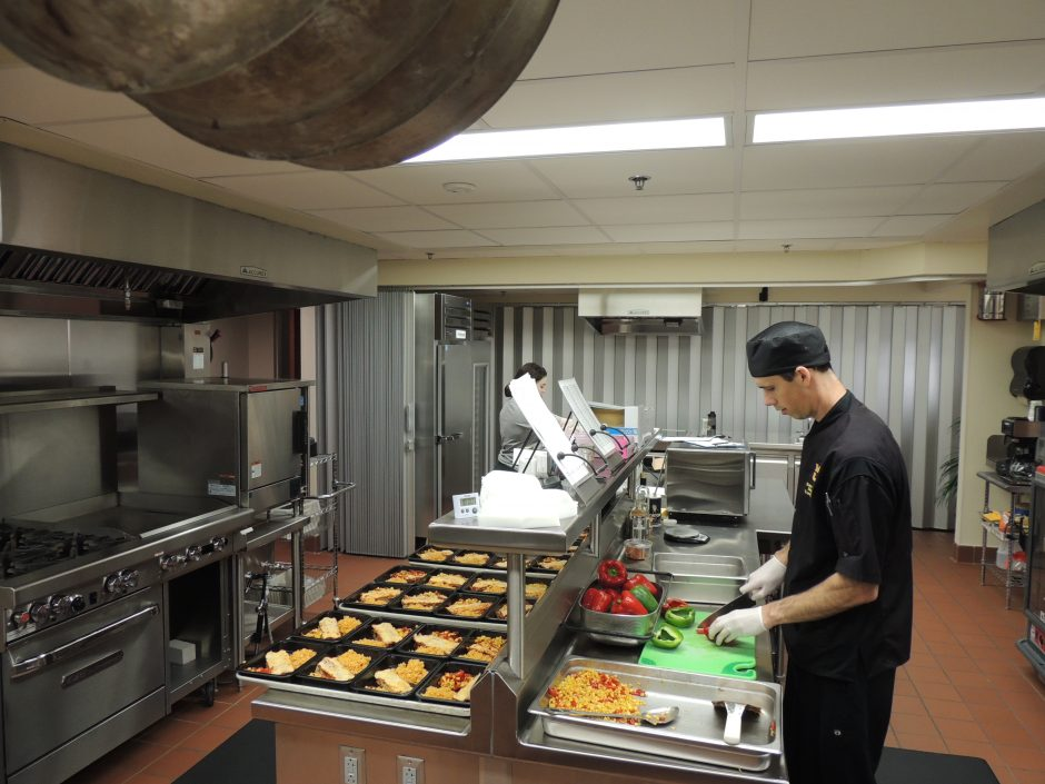 This is a photo of a research chef preparing meals.