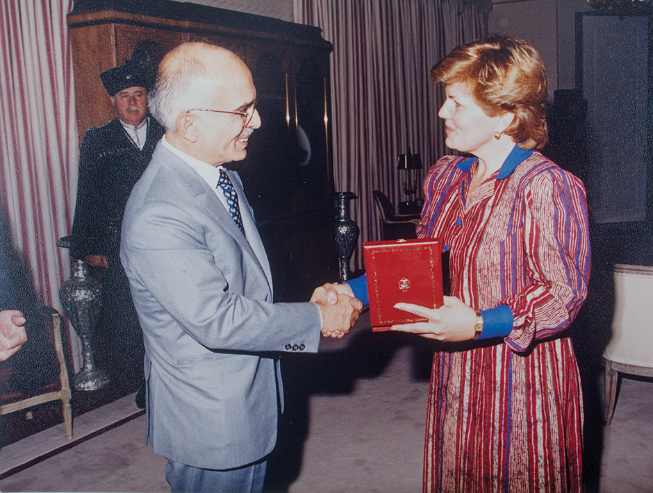 Fritz receives a Medal of Honor medallion from King Hussein bin Talal of Jordan for her work assessing the country's 28-hospital system.