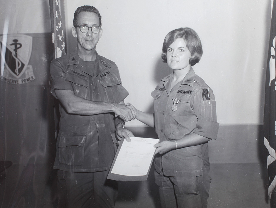 Capt. Fritz receives her second U.S. Army commendation medal from Col. Cochran in 1970.