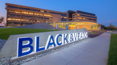 black & veatch sign at night in front of large building