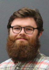 headshot of student with a beard and glasses