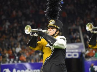 This is a picture of Brianne O'Sullivan playing trumpet in Marching Mizzou