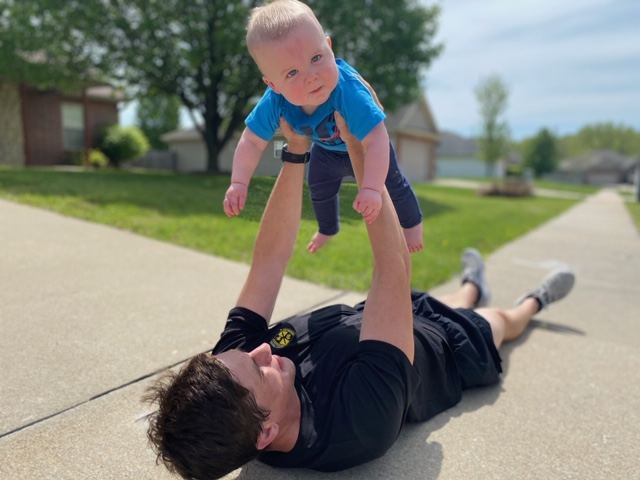Patrick Seeling works out from home with his child Murphy. Seeling is a senior at MU, the Army Ranger Company Commander, and a distinguished Military Graduate. During his enlisted military career, he was a distinguished Leadership Awardee from Basic Leaders Course and completed a deployment to Afghanistan in 2016.