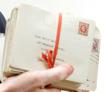 An envelope in a bundle tied with ribbon addressed to Emily Hale at her address in Massachusetts. Photo by Shelley Szwast, courtesy of Princeton University Library