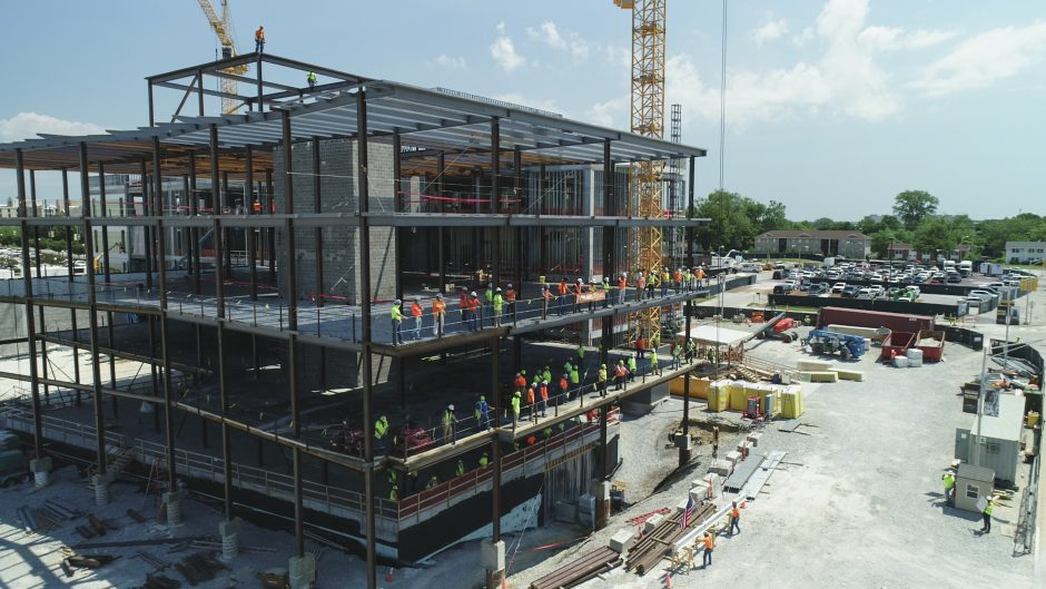 Construction specialists celebrate the topping off of the NextGen Precision Health Institute on June 18, 2020.