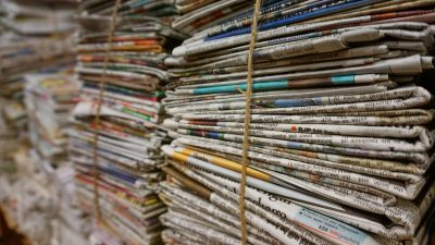 this is a picture of stacks of newspapers