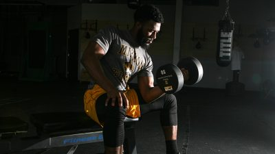 man working out lifting weights