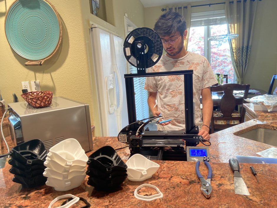This is an image of Ashul Soni using the 3D printer to make the masks.
