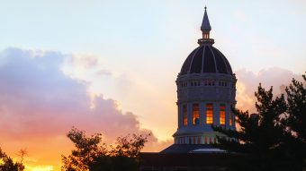 summer clouds hide sunset behind Jesse dome taken from lowry mall