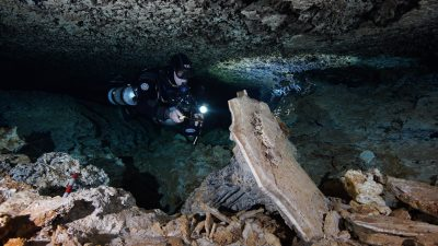 This is a picture of a cave diver in Mexico's ancient underwater ochre mine.