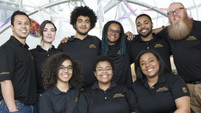 group of diverse students smiling