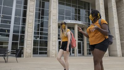 Student wear face coverings outside the Student Center July 21, 2020. Sam O'Keefe/University of Missouri