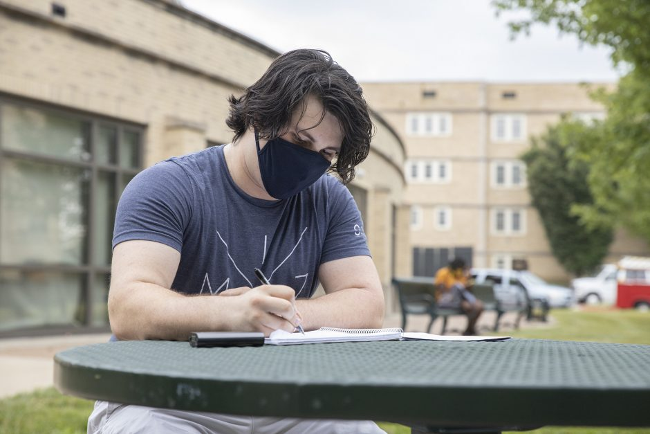 student outside at table working