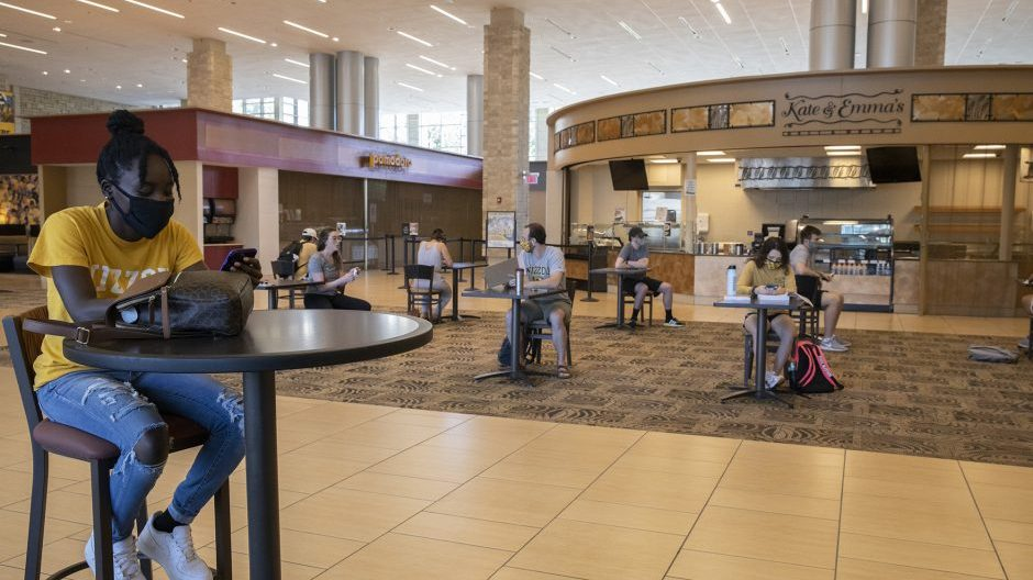 students in the student center working and eating