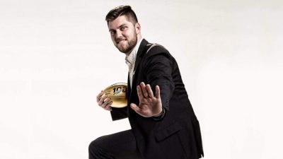 minter holding a gold football