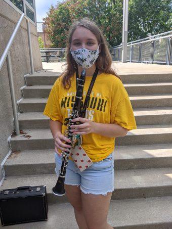 emily kirkham holding a clarinet