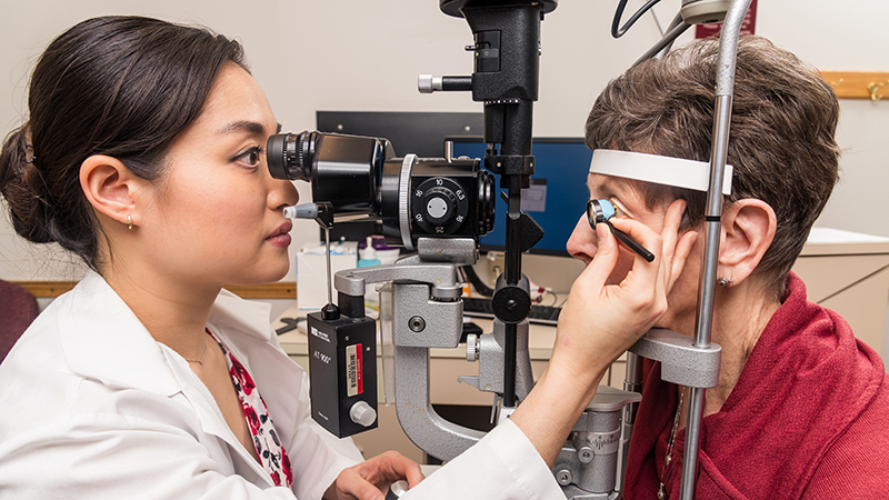 photo of ophthalmologist treating a patient's eye