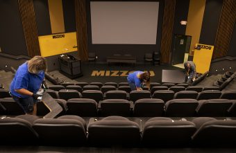 Members of the Mizzou Campus Facilities custodial crew clean Ketcham Auditorium in anticipation of students returning to campus.