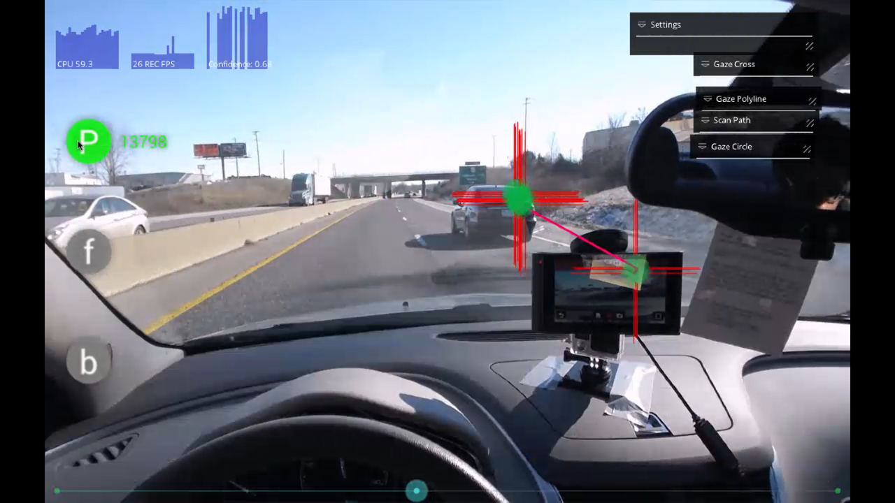A windshield view shows what drivers are paying attention to, in this case, a nearby car in another lane