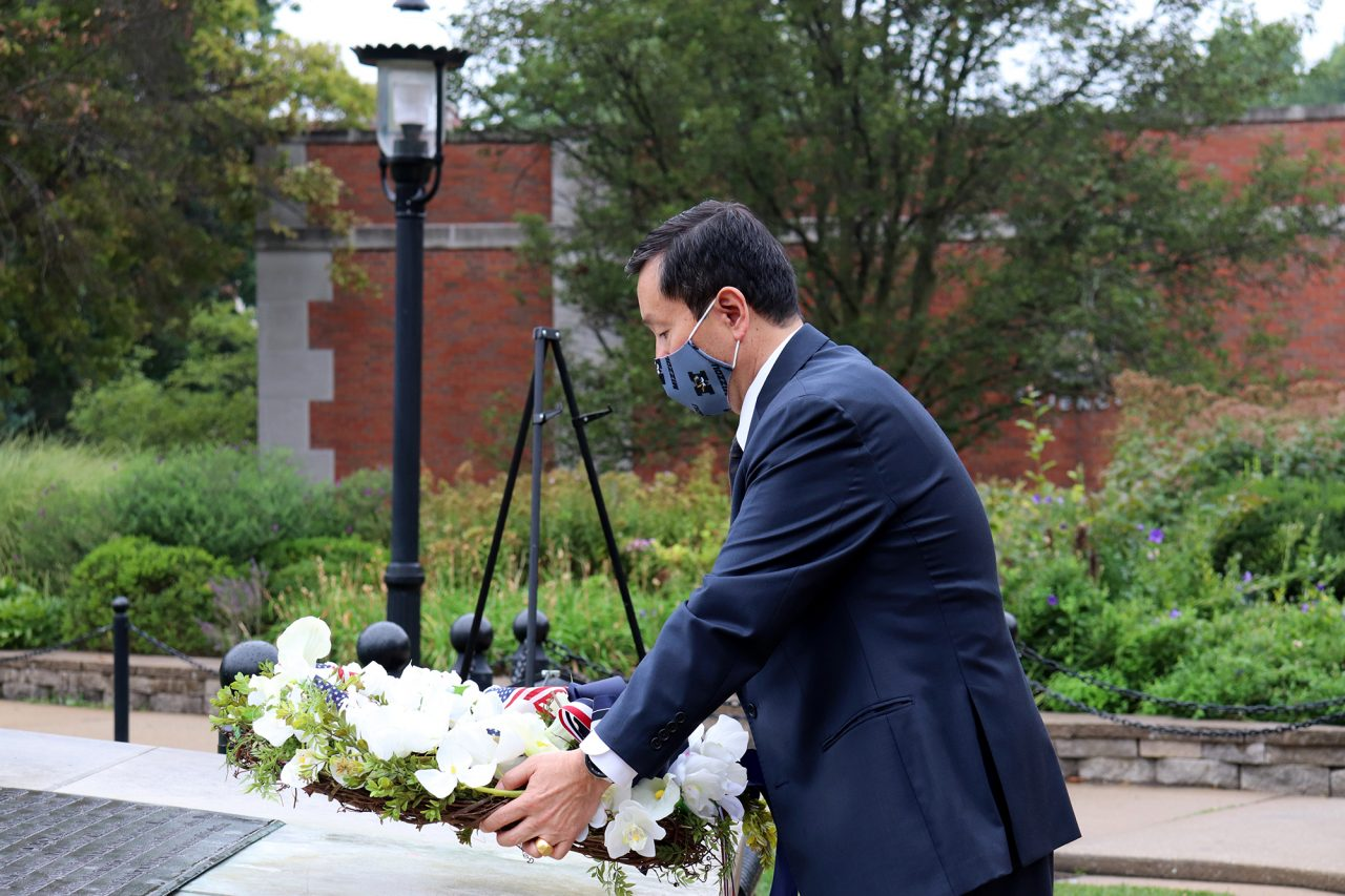 Student, staff, alumni and faculty veteran representatives watched UM System President and MU Chancellor Choi as he placed the wreath for the community to view.