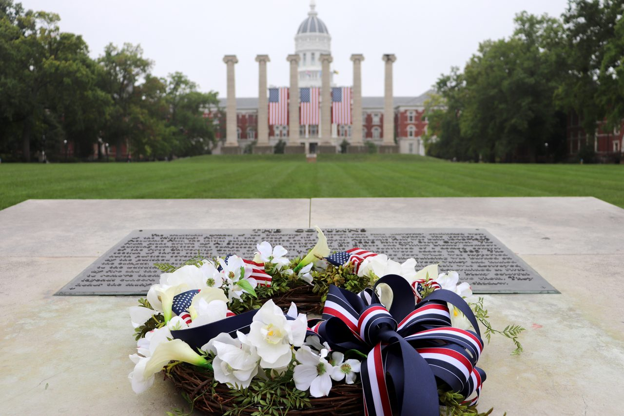A wreath sits on the cement marker on the Quad Sept. 11, 2020, in commemoration of Patriot Day.