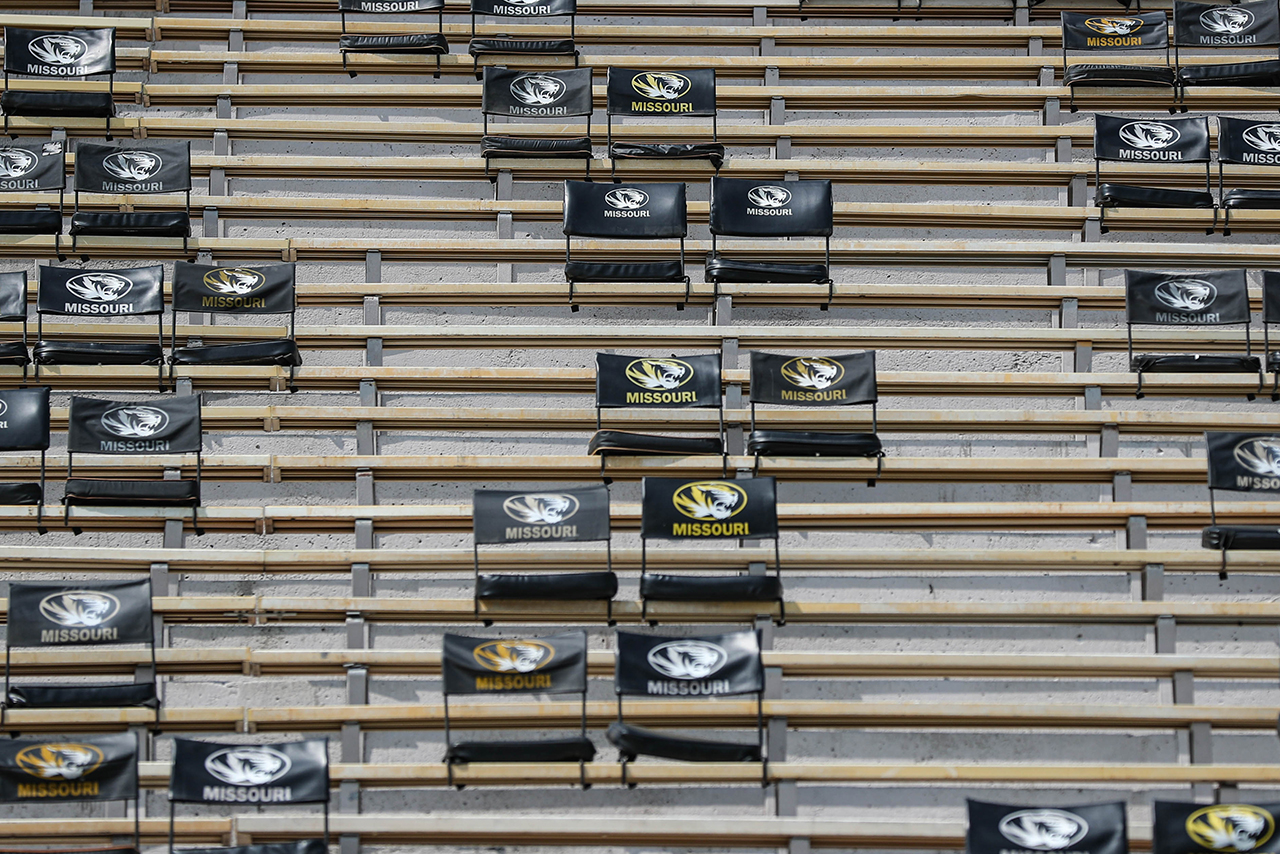 seats with backs are spread throughout the stadium