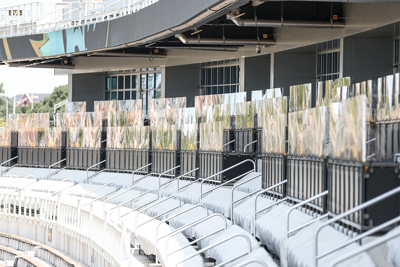 the stadium with plexiglass coverings between boxed seats