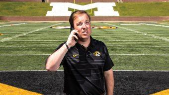 drinkwitz on football field on phone