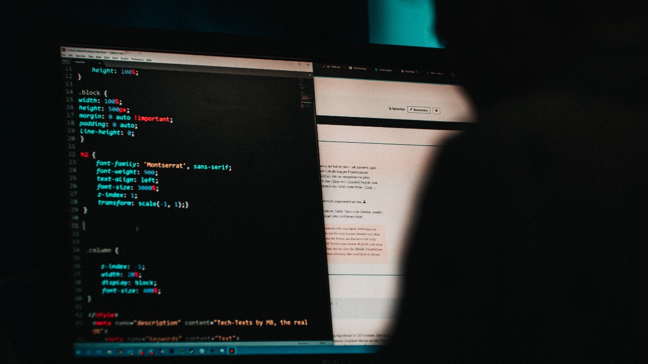 This is a picture of a person working on website code