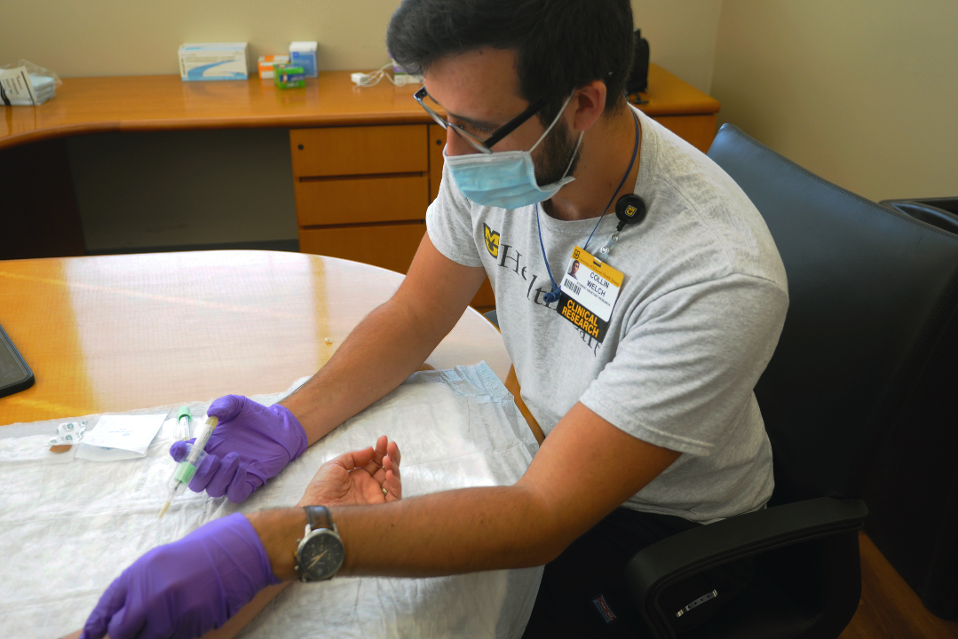 This is an image of a member of the research team drawing a blood sample.