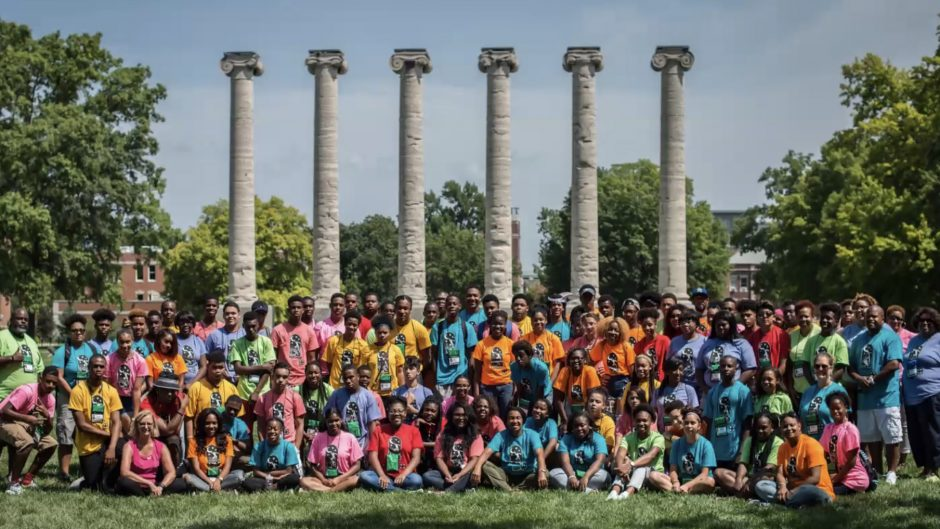 group photo in front of columns